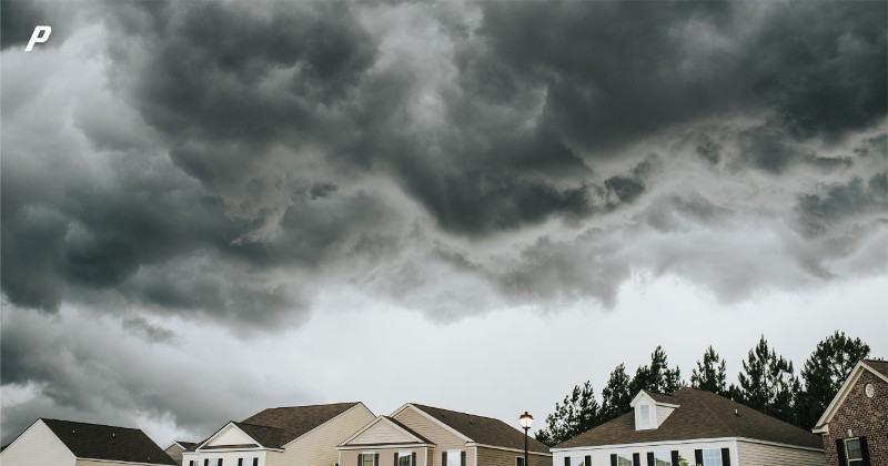 storm clouds over homes