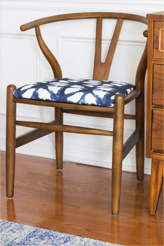 Wooden chair with blue and white cushion