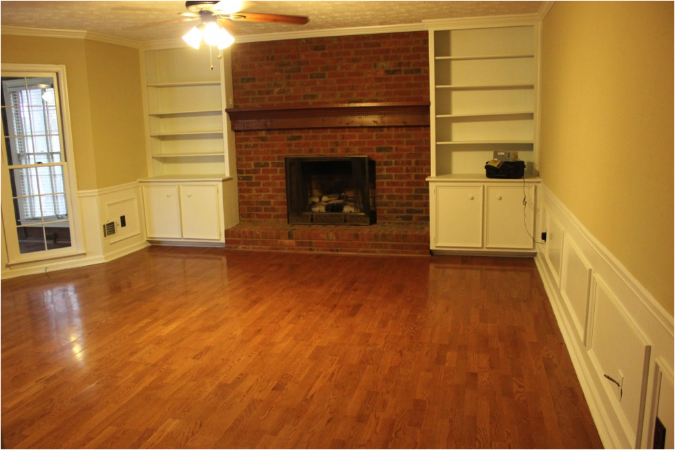 Red brick fireplace with firewood
