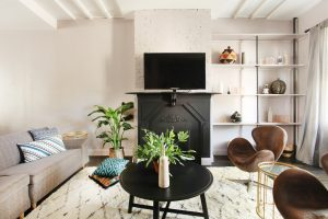Entertainment room with black coffee table and mounted television