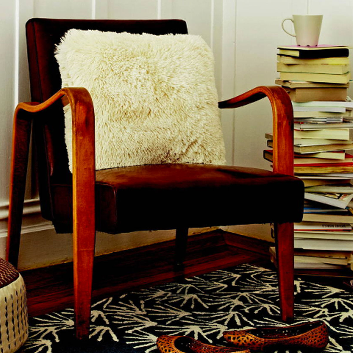 sheepskin pillow and stack of books