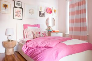 Girl's bedroom with pink bedding and girly accents