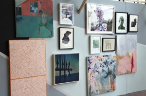 Gallery wall with colorful paintings