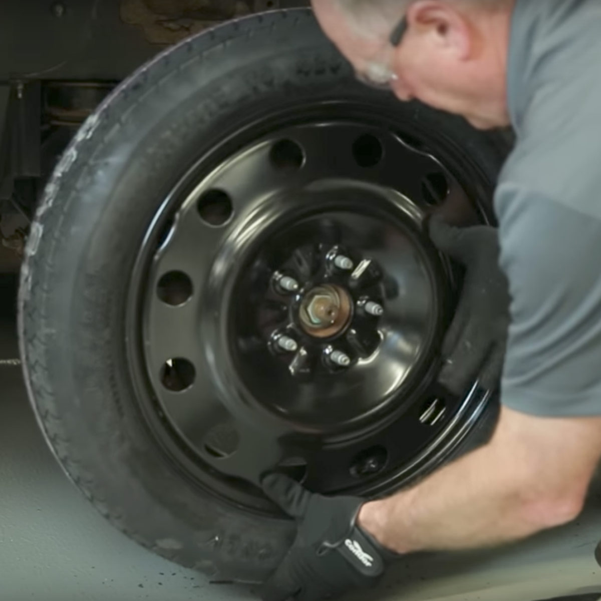 professional changing a car tire
