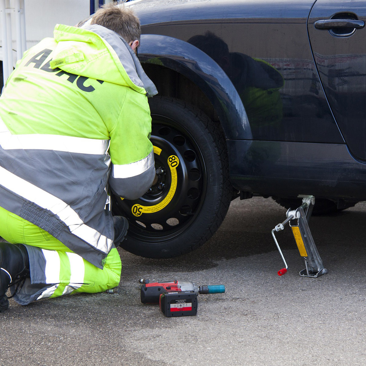 car on jack getting tire changed