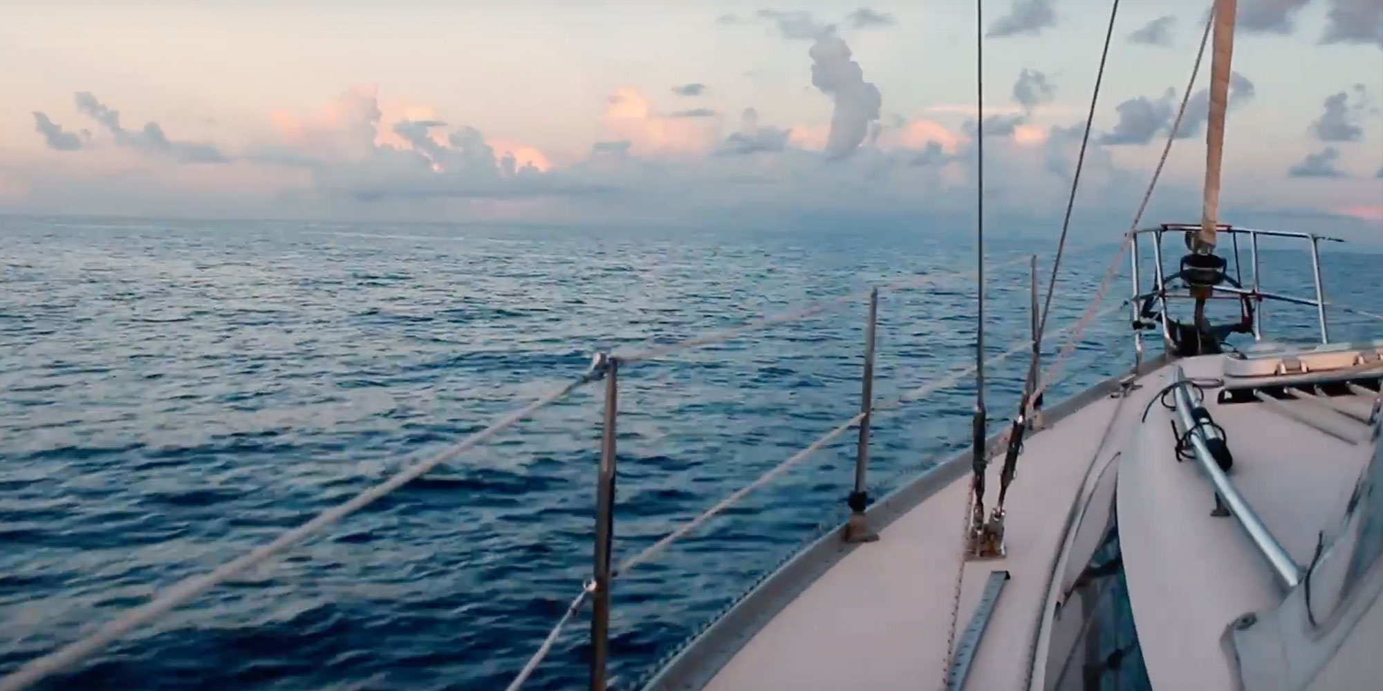 bow of sailboat in Caribbean at sunset