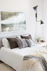 white bedroom with platform bed