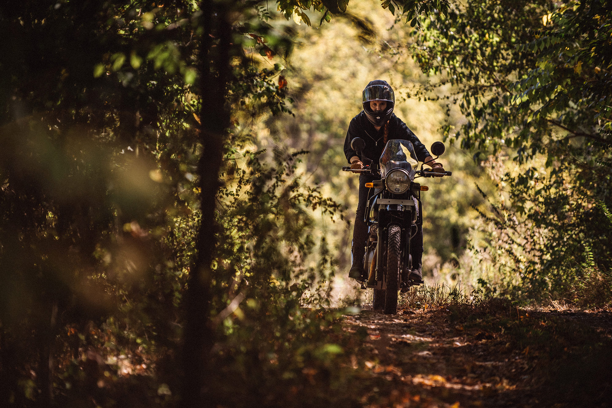 woman on motorycle on dirt path