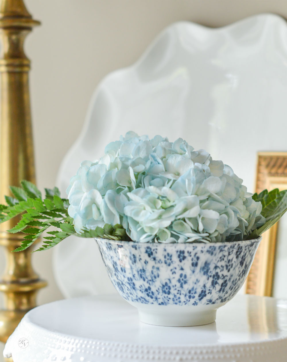 vase of blue hydrangeas