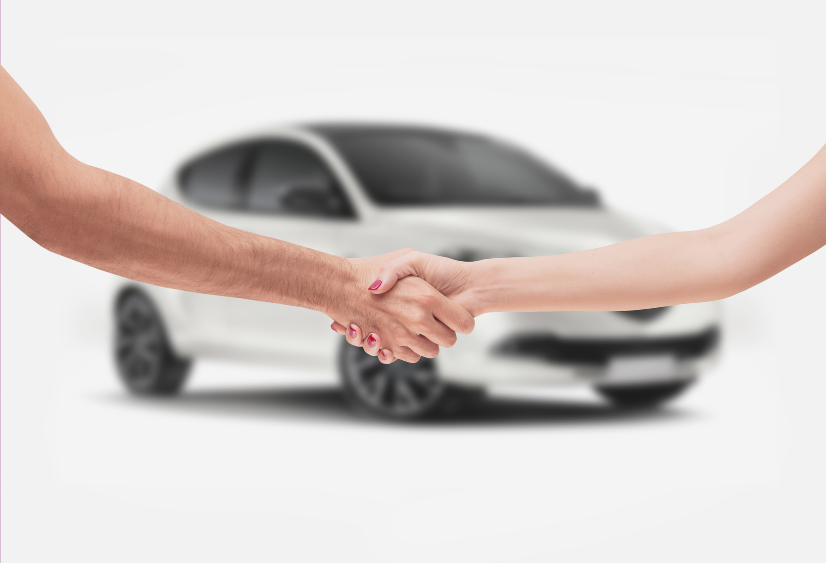 handshake in front of car