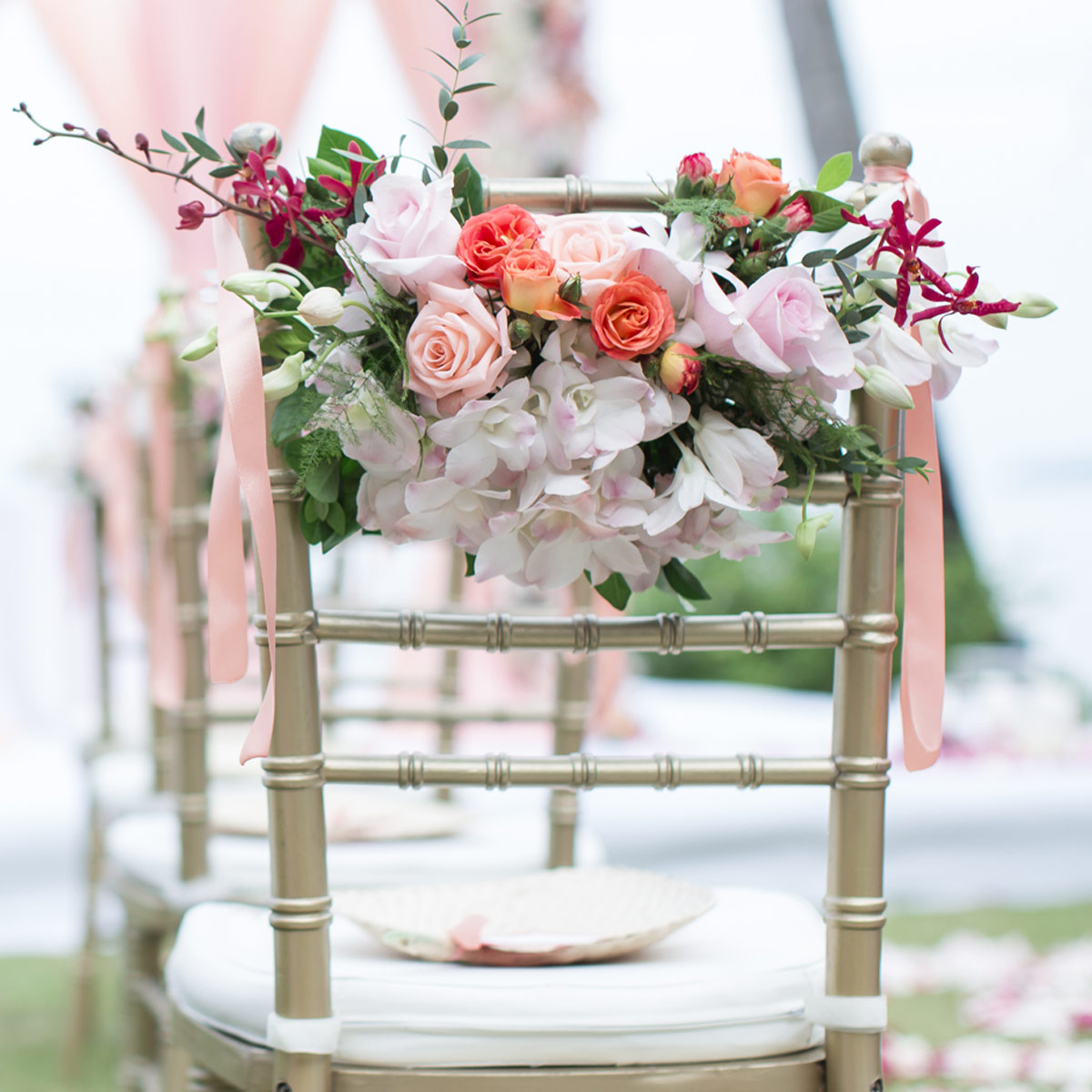 gold chivari chairs with flowers