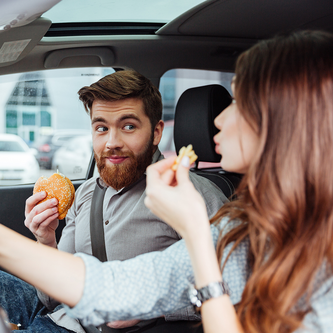 Couple eating in car