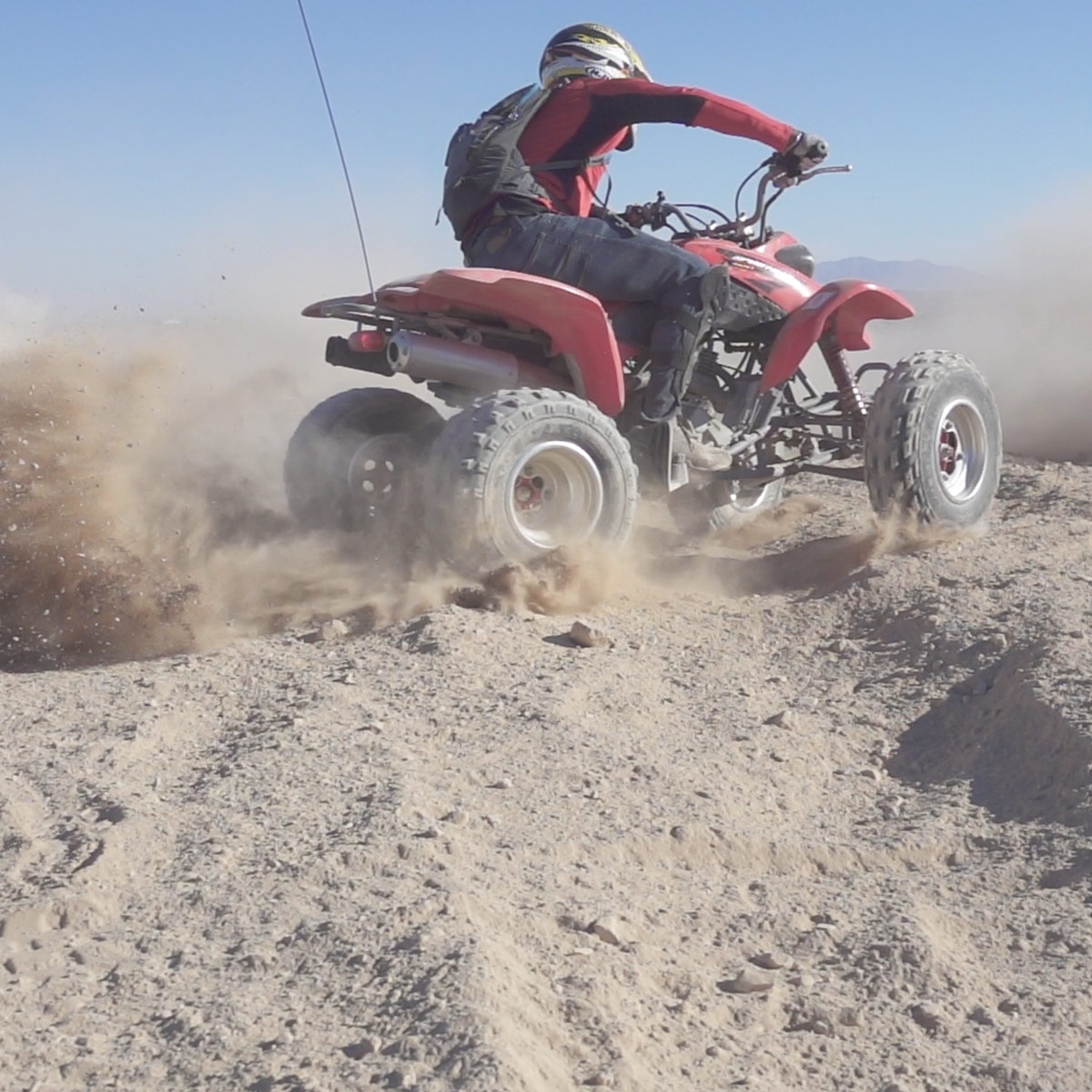 riding ATV in the dirt