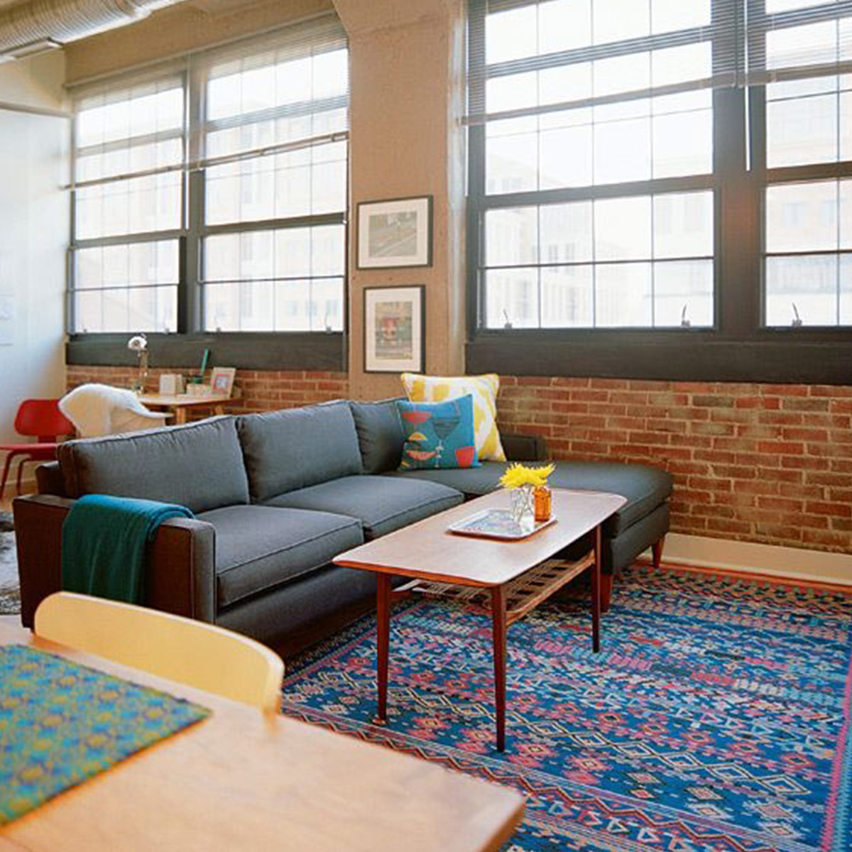 loft with bright colored rug