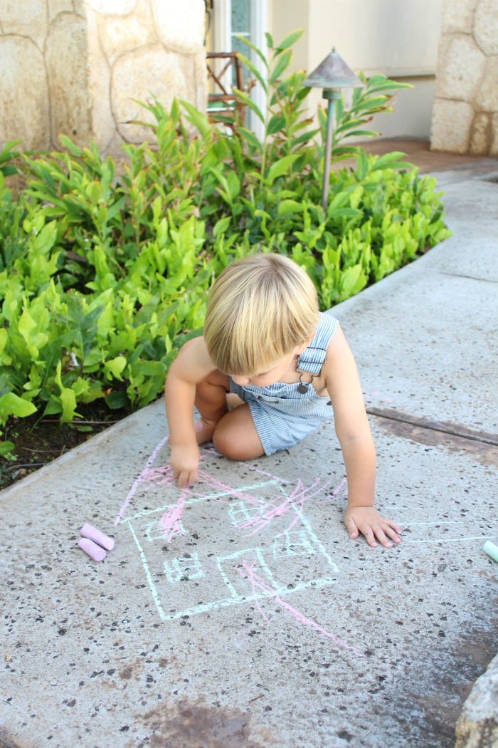 toddler playing with chalk