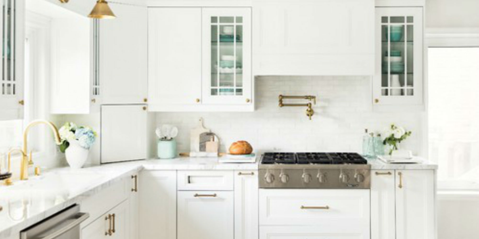 all white kitchen with gold fixtures