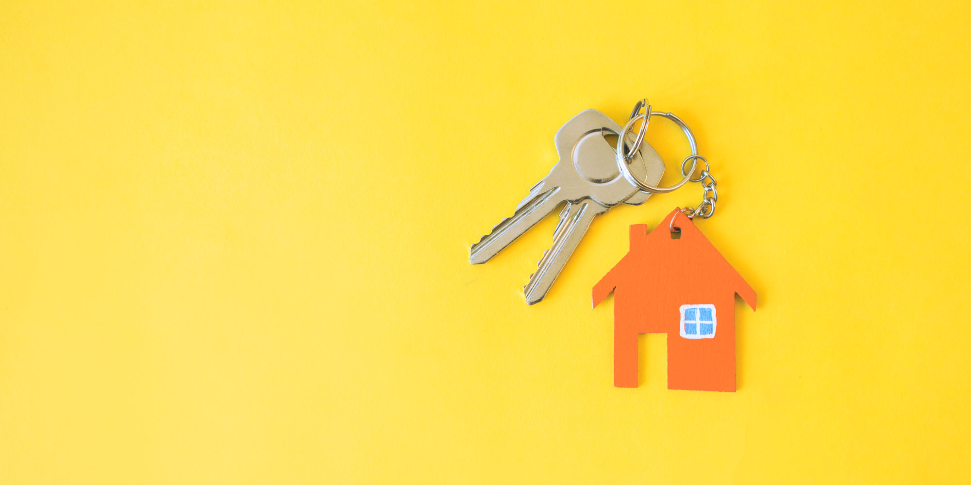 keys to house on bring yellow background