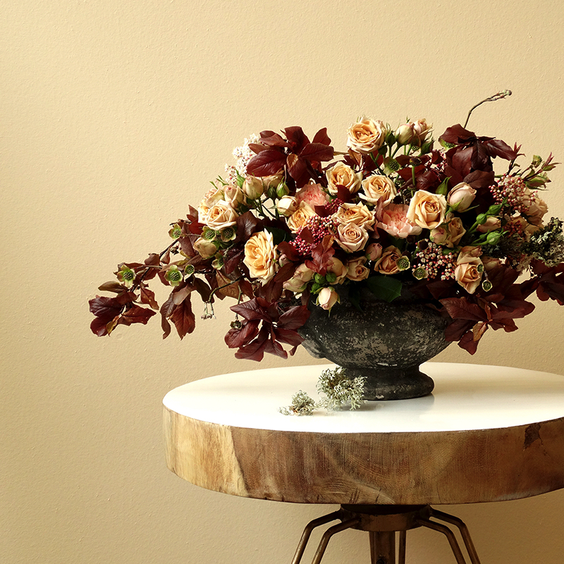flower arrangement on side table