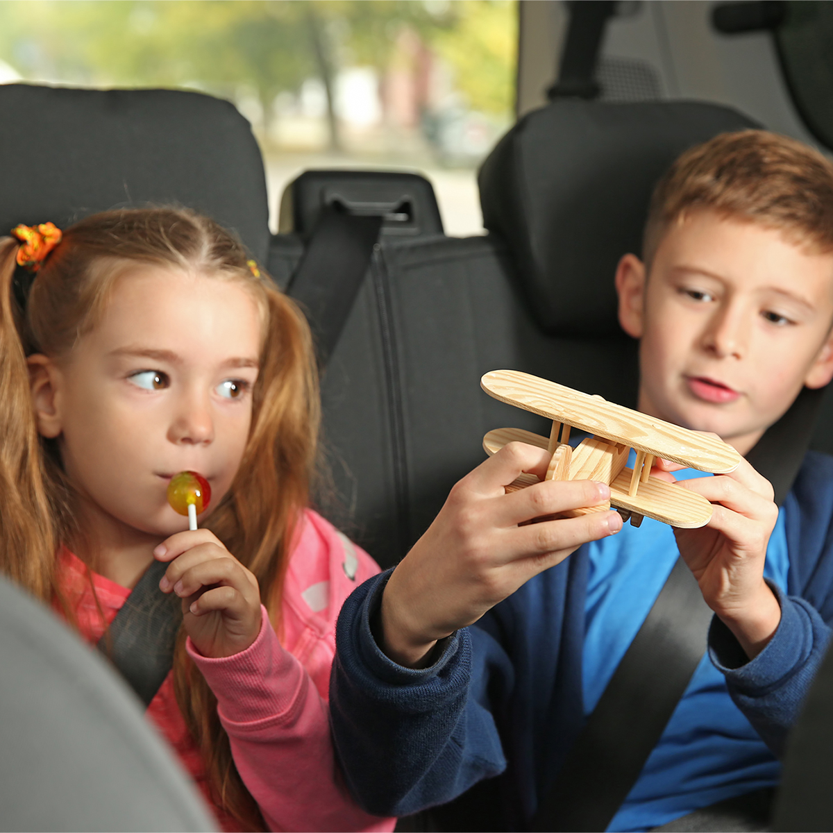 children in the backseat of a car
