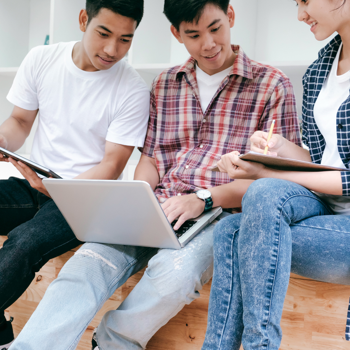 group of students looking at a computer