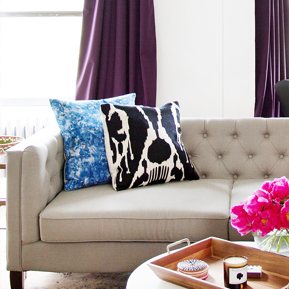 brightly colored pillows on a neutral couch