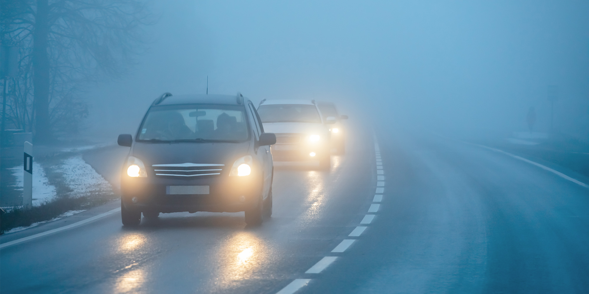 cars driving in heavy fog