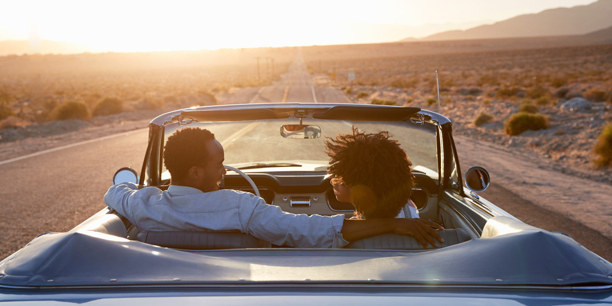 couple in a classic convertible car