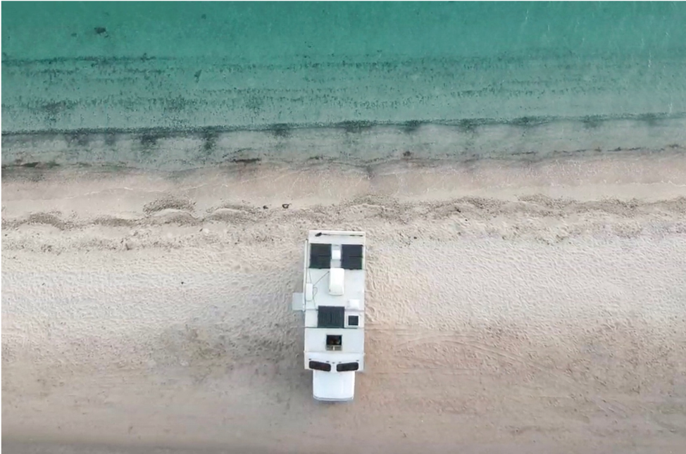 Aerial view of RV roof next to ocean