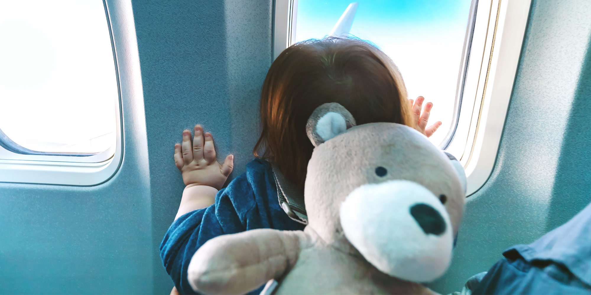 toddler at airplane window