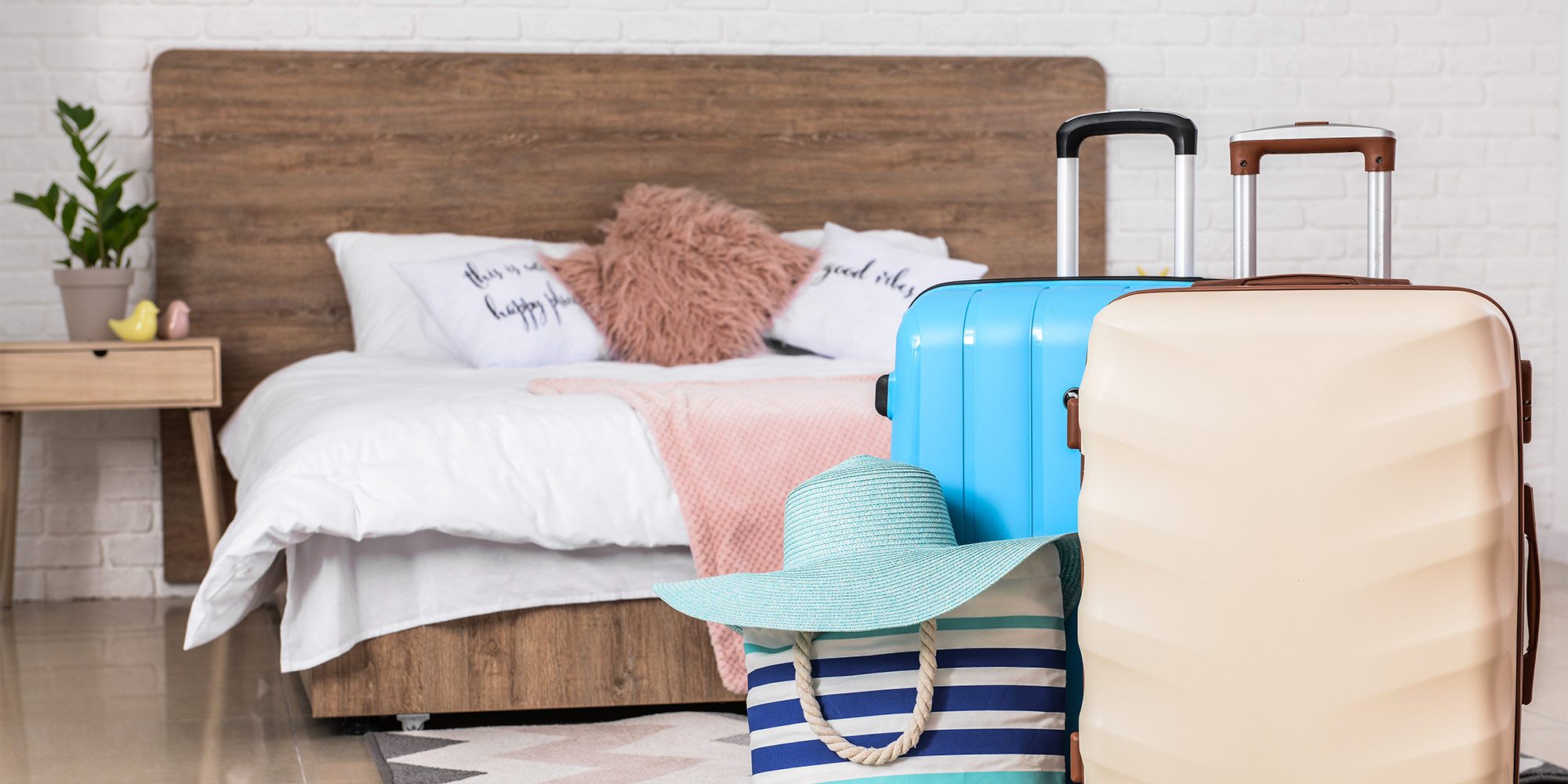 luggage in front of wood bed