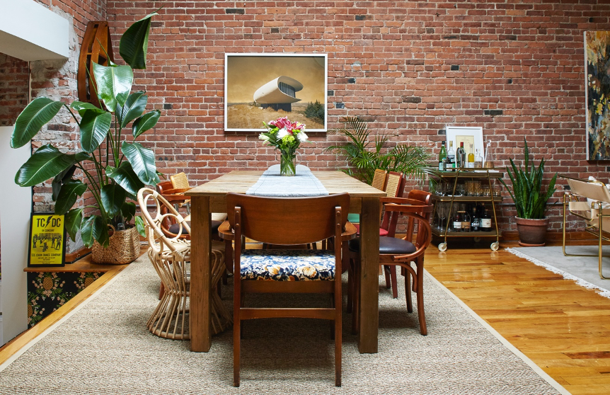 Dining room with brick wall and plants