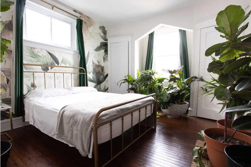 White bed with greenery surrounding