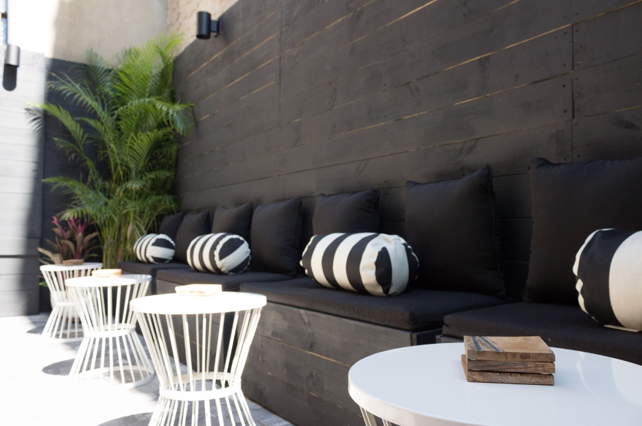 Backyard seating against a wall